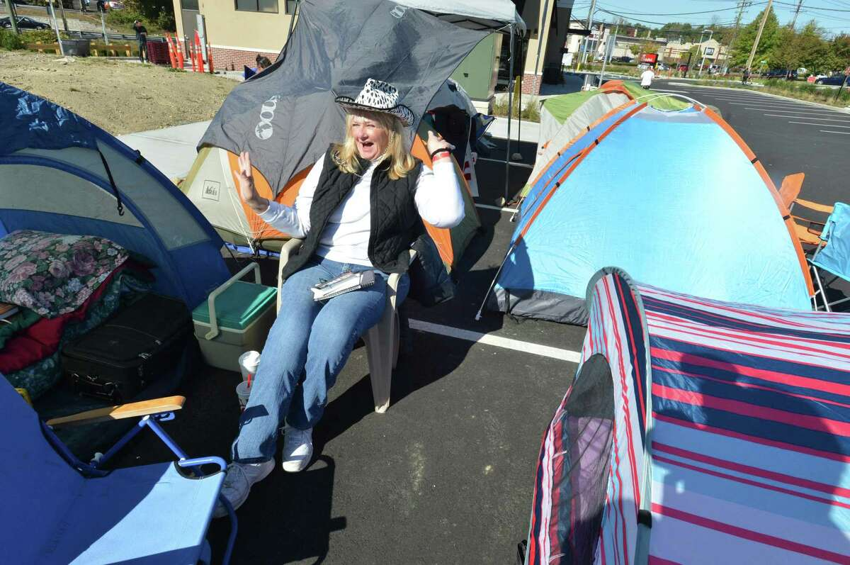 Darien's Carol Rumsey has the cow print hat ready while camping out to win 52 combo meal vouchers for the first 100 people at the new Chick-fil-A in Norwalk. About two dozen were camped out on Wednesday October 18, 2017 until Thursday morning's grand opening of the new Chick-fil-A on Connecticut Ave. in Norwalk Conn.
