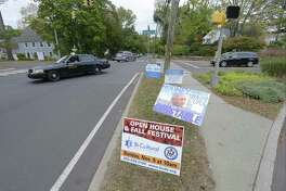 Shown in a photograph taken on Saturday, Oct. 14, 2017 at the corner of Upland Road and Strawberry Hill Avenue in Stamford, Connecticut businesses are sticking advertising signs  among Campaign signs in the city rights of way, which is which is illegal. Campaign signs however are legal, but must be removed within seven days following the election.