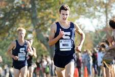 At right, William Landowne of Staples High School the 2nd place finisher during the boys high school FCIAC Cross Country Championship race at Waveny Park in New Canaan, Conn., Wednesday, Oct. 18, 2017.