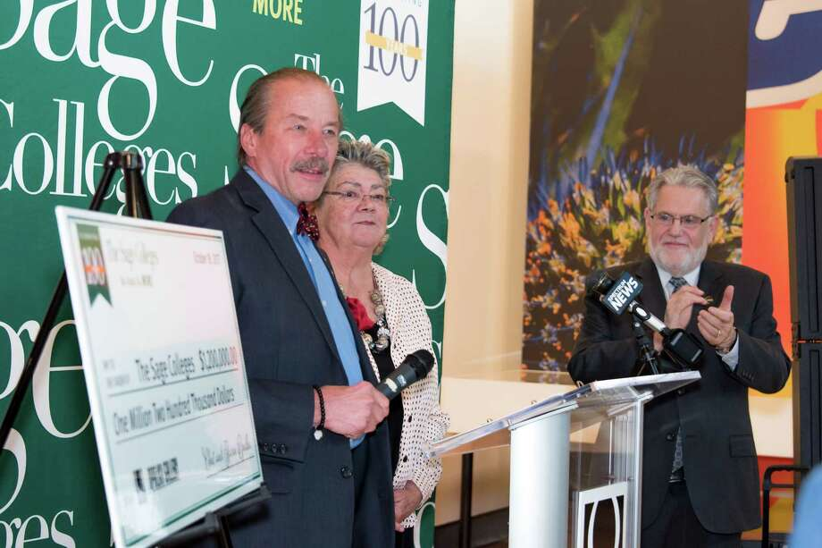 Chet Opalka, left, Karen Opalka and Dr. Christopher Ames, president of The Sage Colleges, in a ceremony announcing the Opalkas' $1.2 million gift to the school's Opalka Gallery. (Courtesy The Sage Colleges) Photo: Tamara_Hansen / © Tamara Hansen 2017