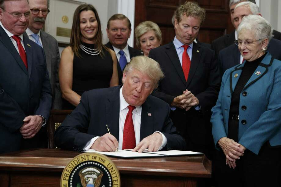 President Donald Trump last week signs an executive order on health care, which will wreak havoc in the market place. Photo: Evan Vucci /Associated Press / Copyright 2017 The Associated Press. All rights reserved.