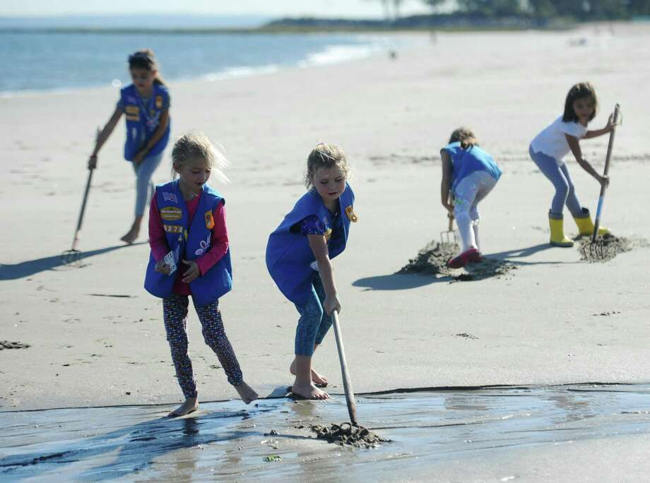 First-graders Katie Neuenfeldt, front left, and Liv Hadley, front center, go shellfishing with other girls from Daisy Scouts Troop 50273 in Old Greenwich during a shellfishing demonstration presented by the Greenwich Shellfish Commission at Greenwich Point Park in Old Greenwich, Conn. Wednesday, Oct. 18, 2017. The girls learned about shellfish and then took to the beach to try shellfishing for themselves. Photo: Tyler Sizemore / Hearst Connecticut Media / Greenwich Time
