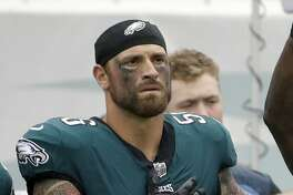 "FILE - In this Oct. 8, 2017, file photo, Philadelphia Eagles' Chris Long (56) is shown during the National Anthem before an NFL football game against the Arizona Cardinals in Philadelphia.  Long is donating the rest of his year's salary to increase educational equality. The Eagles' defensive end already gave up his first six game checks to provide two scholarships for students in Charlottesville, Virginia. Now, he's using the next 10 to launch the Pledge 10 for Tomorrow campaign. ""My wife and I have been passionate about education being a gateway for upward mobility and equality,"" Long told The Associated Press. (AP Photo/Matt Rourke, File)"