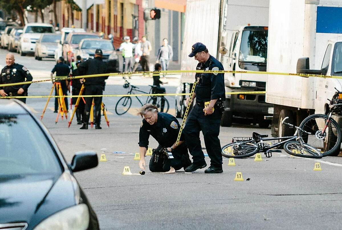 SFPD investigators take photos of the scene where a man struck an officer with his vehicle and fled on Turk Street near Van Ness Avenue in San Francisco, Calif., Wednesday, October 18, 2017. The suspect was reported to flee on foot heading east in the Panhandle Park.