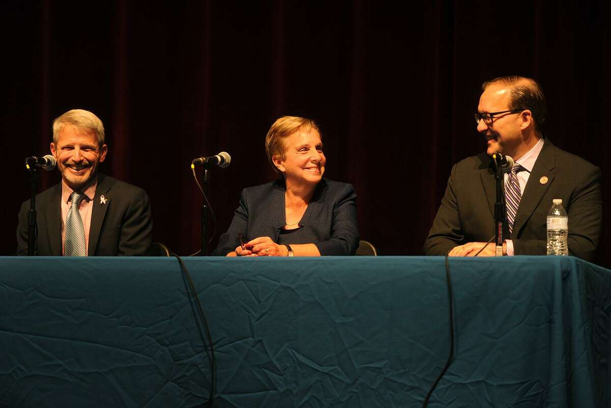 From left; First Selectman candidates Independent Michael Redgate, Democrat Vicki Tesoro, and Republican Paul Lavoie participate in a debate at Trumbull High School in Trumbull, Conn. on Tuesday, October17, 2017.