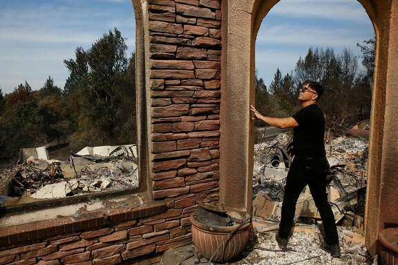 Boback Emad surveys the destruction of his home for the first time in the Fountaingrove neighborhood Oct. 17, 2017 in Santa Rosa, Calif. Emad lost his home along with a career's worth of his artwork, which he had just moved back to his house as he was preparing to move it to a different facility. Emad was also an art collector and he lost several valuable pieces.