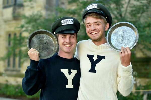 "New Haven, Connecticut - Wednesday, October 18, 2017:  Yale University students Hudson Walberg,  left, and Alec Emser of the Yale Mens Ultimate Frisbee team on the Yale campus hold  Frisbie's Pies pie plates Wednesday while sporting Frisbie's Pies hats used by deliverymen of the original Frisbie's Pies company of Bridgeport. The pie plates were the original ""flying discs""."