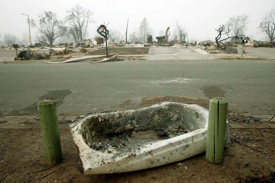 A bathtub rests on a curb on Mocha Lane in the Coffey Park neighborhood of Santa Rosa, Calif. on Wednesday Oct. 18, 2017. Potential tornado-like conditions whipped up by the firestorm may have tossed cars and other objects into the air and depositing them elsewhere.