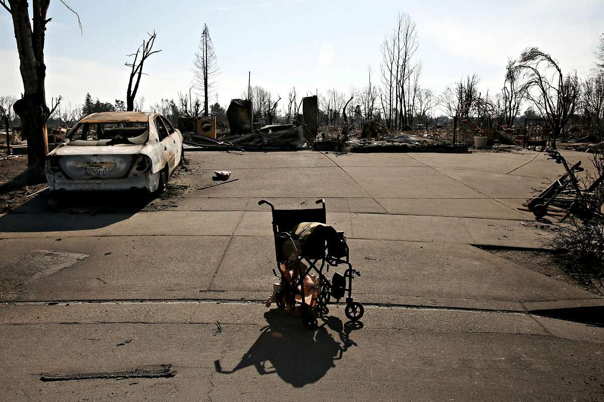 The home where Irene Lopez was rescued from lays in ruins and her wheelchair still sits partially melted in the driveway in the Coffey Park neighborhood on Oct. 17, 2017 in Santa Rosa, Calif.