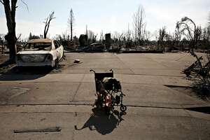 The home where Irene Lopez was rescued from lays in ruins and her wheelchair still sits partially melted in the driveway in the Coffey Park neighborhood Oct. 17, 2017 in Santa Rosa, Calif.