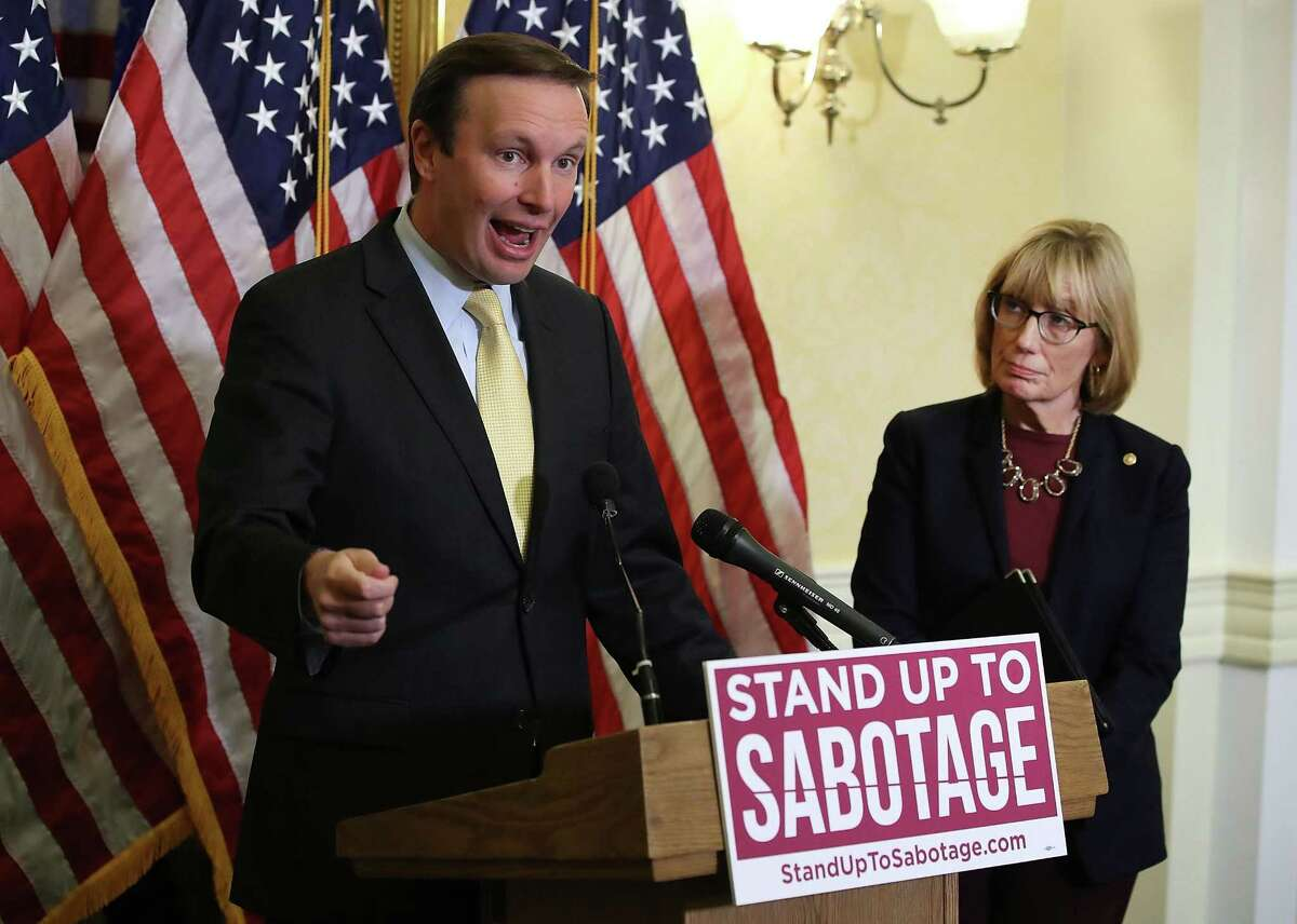 Chris Murphy, D-Conn. and Sen. Maggie Hassan D-NH participate in a news conference regarding healthcare and President Trump's effort to repeal the Affordable Care Act., on Capitol Hill in Washington on Tuesday.