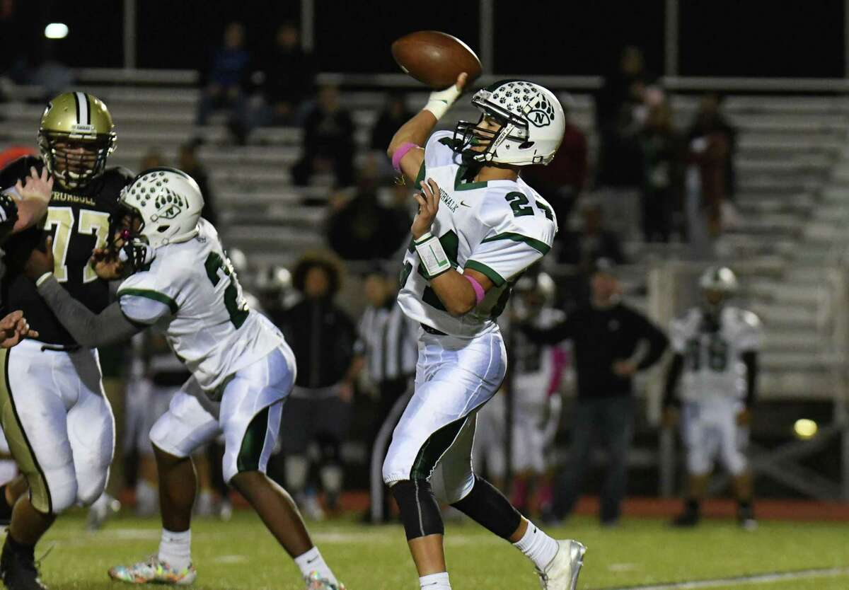 Quarterback Kyle Gordon (24) of the Norwalk Bears releases a pass during a game against the Trumbull Eagles at Trumbull High School on Friday October 13, 2017 in Trumbull, Connecticut.