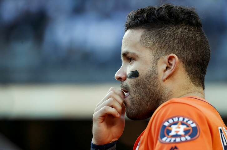 Houston Astros second baseman Jose Altuve stands in the dugout duriing the second inning of Game 5 of the ALCS against the New York Yankees at Yankee Stadium on Wednesday, Oct. 18, 2017, in New York. ( Karen Warren  / Houston Chronicle )