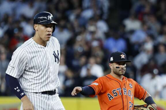 New York Yankees right fielder Aaron Judge, left, stands on second base next to Houston Astros second baseman Jose Altuve (27) after hitting an RBI double during the third inning of Game 5 of the ALCS at Yankee Stadium on Wednesday, Oct. 18, 2017, in New York. ( Michael Ciaglo / Houston Chronicle )