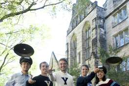 Dan O'Conner, owner of Frisbie's Pies of Bridgeport, front, with Yale University students Daniel Monteagudo, Hudson Walberg, Alec Emser, Ella Schmidt and Isabelle Carson, of the Yale men's and women's Ultimate Frisbee teams.