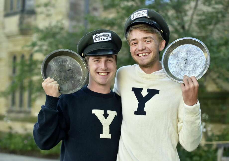 """New Haven, Connecticut - Wednesday, October 18, 2017:  Yale University students Hudson Walberg,  left, and Alec Emser of the Yale Mens Ultimate Frisbee team on the Yale campus hold  Frisbie's Pies pie plates Wednesday while sporting Frisbie's Pies hats used by deliverymen of the original Frisbie's Pies company of Bridgeport. The pie plates were the original """"flying discs"""". Photo: Peter Hvizdak / Hearst Connecticut Media / New Haven Register"""