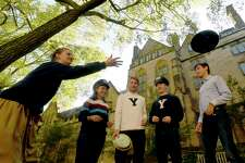 """New Haven, Connecticut - Wednesday, October 18, 2017: Yale University students Ella Schmidt, Isabelle Carson, Alec Emser, Hudson Walberg, and Daniel Monteagudo,of the Yale Men's and Women's Ultimate Frisbee team practice throwing Frisbie's Pies of Bridgeport pie plates Wednesday on the Yale campus in New Haven, The Frisbie's Pies are the original """"flying discs""""."""