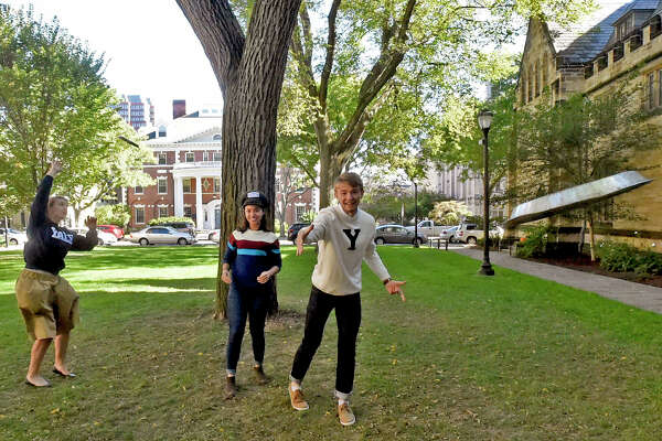 """New Haven, Connecticut - Wednesday, October 18, 2017:   Yale University students  Ella Schmidt, Isabelle Carson and Alec Emser, left to right, of the Yale Men's and Women's Ultimate Frisbee team practice throwing Frisbie's Pies pie plates  on the Yale campus in New Haven Wednesday. The Frisbie Pies of Bridgeport pie plates are  the original """"flying discs"""""""