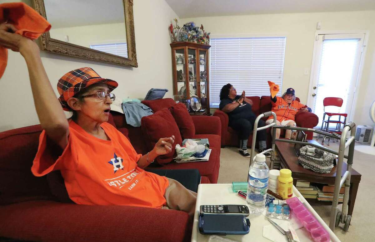 Euginia Rios (left-right), Darlene Lang and Ardie Rocha watch Game 5 of the ALCS Wednesday, Oct. 18, 2017, in Baytown. Rios is a die hard Astros fan has been battling brain cancer hopes to see the Astros win a championship.