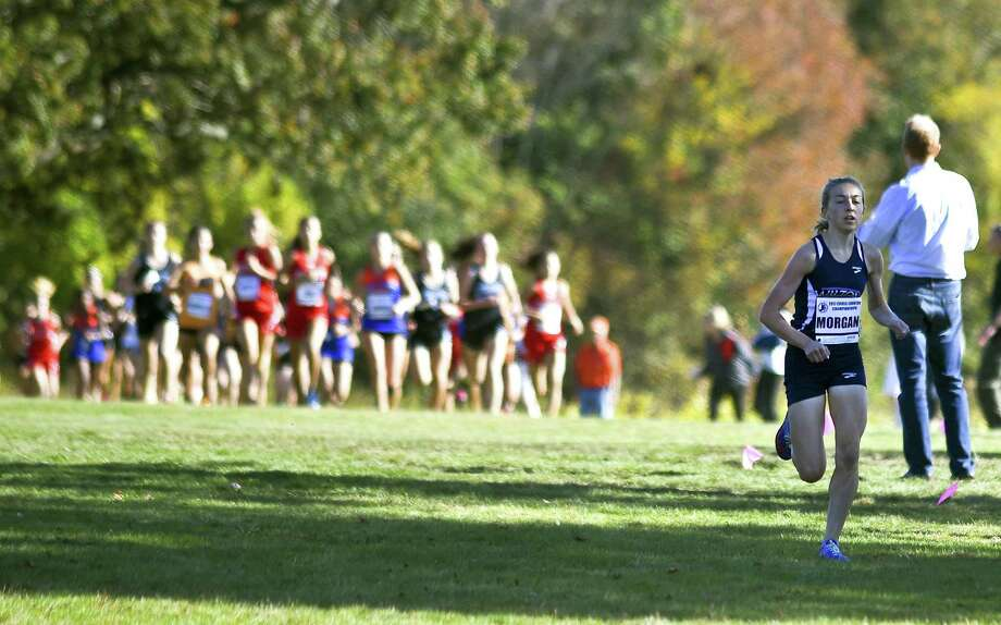 Wilton Morgan McCormick, at right, takes the lead to a first place finish in the FCIAC Girls Cross Country Championships at Waveny Park in New Canaan, Connecticut on Wednesday, Oct.18, 2017. McCormick cross the finish line with a time of 13:44.83. Photo: Matthew Brown / Hearst Connecticut Media / Stamford Advocate