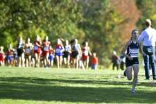 Wilton Morgan McCormick, at right, takes the lead to a first place finish in the FCIAC Girls Cross Country Championships at Waveny Park in New Canaan, Connecticut on Wednesday, Oct.18, 2017. McCormick cross the finish line with a time of 13:44.83.