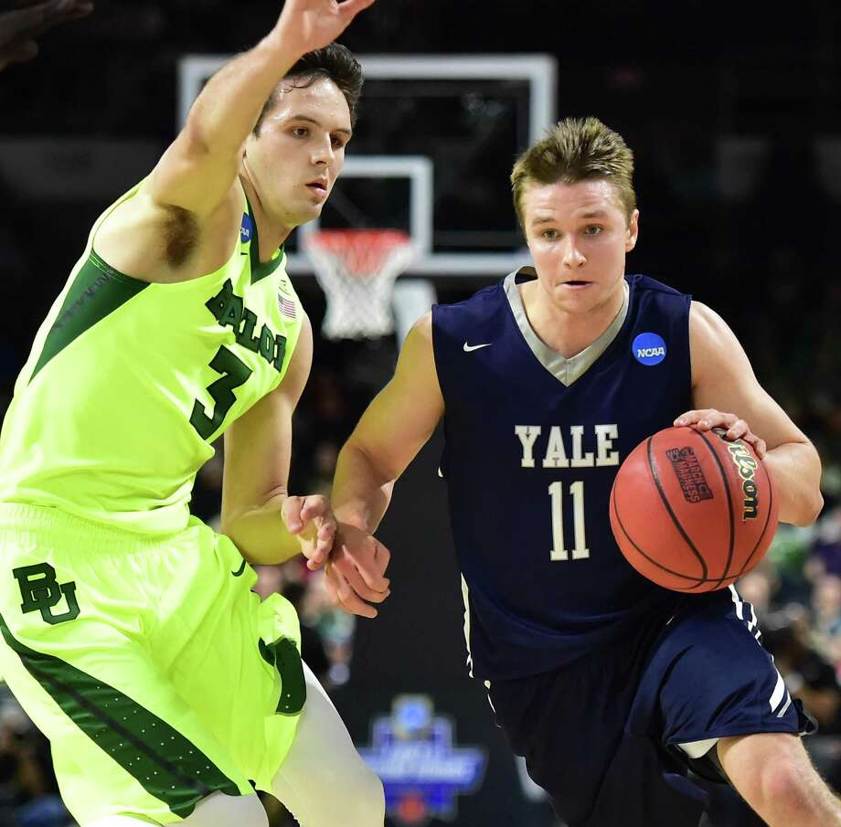 Yale's Makai Mason drives to the hoop as Baylor's Alex Copeland defends in the 79-75 victory for the Bulldogs in the first round of the 2016 NCAA Men's Basketball Tournament at the Dunkin' Donuts Center in Providence, RI.  (Catherine Avalone/New Haven Register) Photo: Catherine Avalone / New Haven RegisterThe Middletown Press