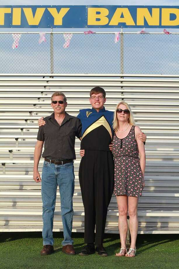 Andrew Henckel, seen with his parents Randy and Whitney Henckel, played baritone in the marching band at Tivy High School in Kerrville. Photo: Courtesy