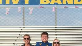 Andrew Henckel, seen with his parents Randy and Whitney Henckel, played baritone in the marching band at Tivy High School in Kerrville.