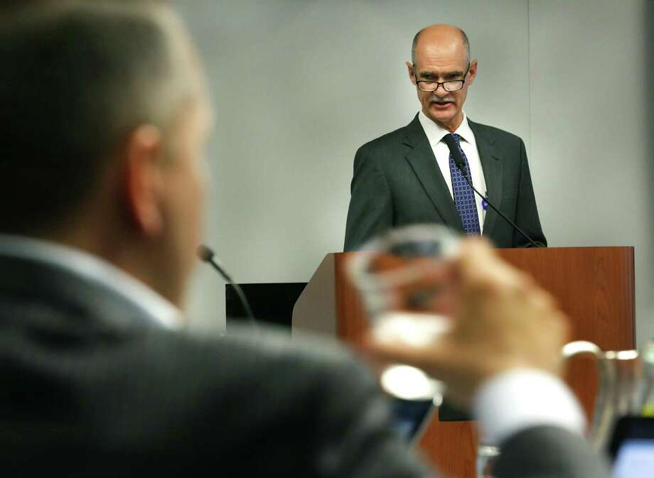 Steve Clouse, right, SAWS chief operating officer, addresses the City Council with a proposed rate hike as Councilman Greg Brockhouse takes a drink of water, during the City Council B Session meeting on Oct. 18. These rate hikes are necessary. Photo: Bob Owen /San Antonio Express-News / ©2017 San Antonio Express-News