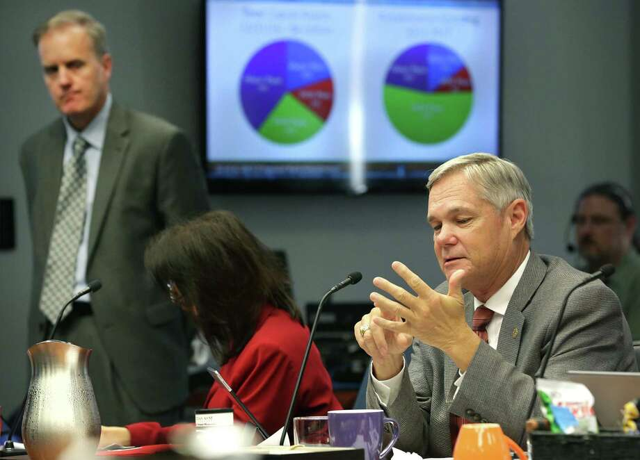 City Council Member Clayton Perry, right, points out why he won't support the San Antonio Water System's proposed rate increases during the City Council B session meeting on Oct. 18, 2017. Doug Evanson, SAWS vice president and chief financial officer, is at left. Photo: Bob Owen /San Antonio Express-News / ©2017 San Antonio Express-News