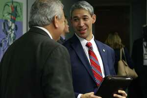 San Antonio Mayor Ron Nirenberg, right, talks with SAWS CEO and President Robert Puente after SAWS directors proposed rate increases during the City Council B Session meeting on Oct. 18, 2017. The City Council will vote Thursday on the new rates.