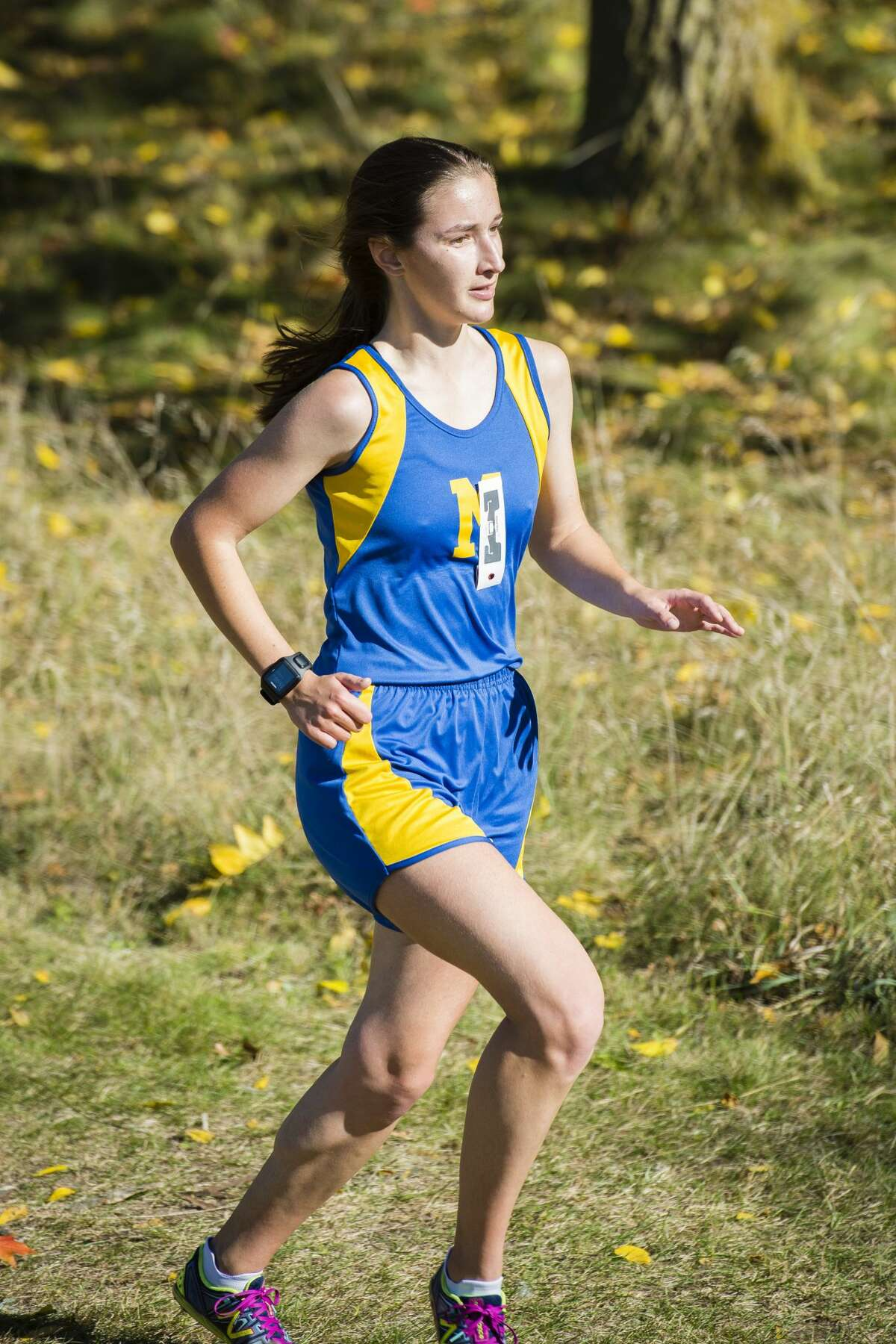 Midland's Emily Yoder runs during a Saginaw Valley League cross country meet in Mount Pleasant on Wednesday, Oct. 18, 2017. (Danielle McGrew Tenbusch/for the Daily News)