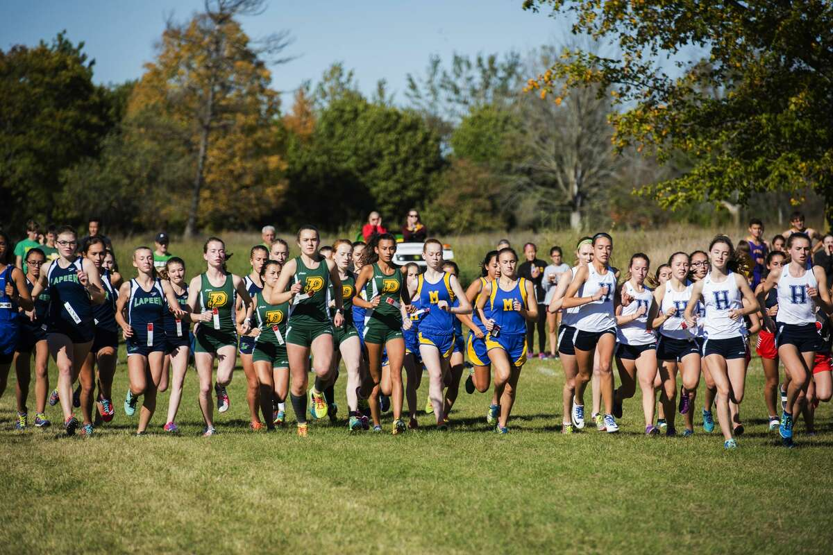 The varsity girls race begins as 64 runners cross the starting line during a Saginaw Valley League cross country meet in Mount Pleasant on Wednesday, Oct. 18, 2017. (Danielle McGrew Tenbusch/for the Daily News)