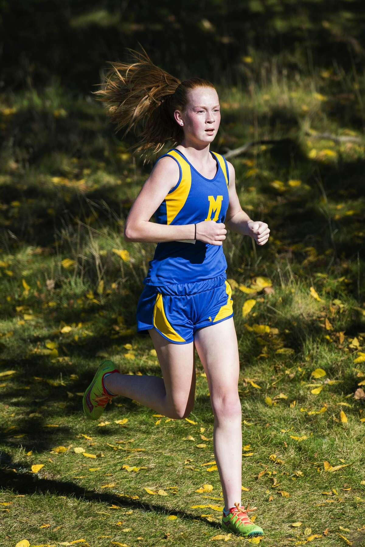 Midland's Emma Rudisel races during a Saginaw Valley League cross country meet in Mount Pleasant on Wednesday, Oct. 18, 2017. (Danielle McGrew Tenbusch/for the Daily News)