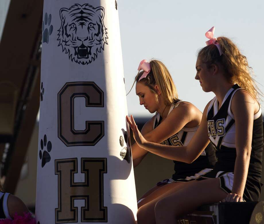 Conroe cheerleader Hannah Pryor, center, works on the team's float during the Conroe High School homecoming parade Wednesday, Oct. 18, 2017, in Conroe. Photo: Jason Fochtman/Houston Chronicle
