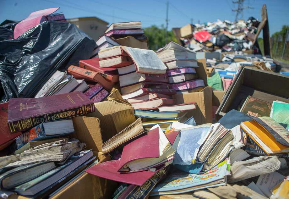 Hundreds of holy books currently sit outside the United Orthodox Synagogues on Greenwillow Street near Brays Bayou after they were removed from the flooded building, Thursday, September 7, 2017. The books will have to be buried because they are holy. (Mark Mulligan / Houston Chronicle) Photo: Mark Mulligan, Staff Photographer / 2017 Mark Mulligan / Houston Chronicle