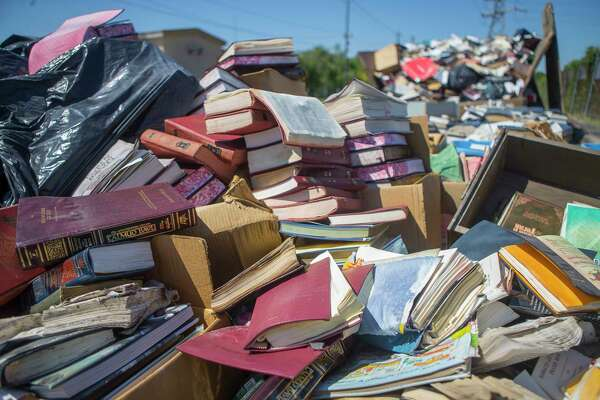 Hundreds of holy books currently sit outside the United Orthodox Synagogues on Greenwillow Street near Brays Bayou after they were removed from the flooded building, Thursday, September 7, 2017. The books will have to be buried because they are holy. (Mark Mulligan / Houston Chronicle)