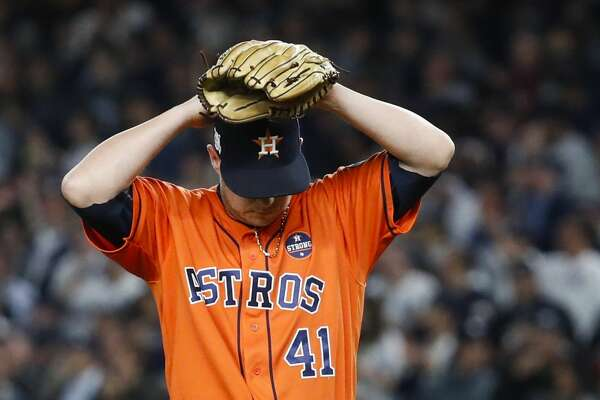 Houston Astros starting pitcher Brad Peacock reacts after giving up a solo home run to New York Yankees catcher Gary Sanchez during the seventh inning of Game 5 of the ALCS at Yankee Stadium on Wednesday, Oct. 18, 2017, in New York. ( Karen Warren  / Houston Chronicle )