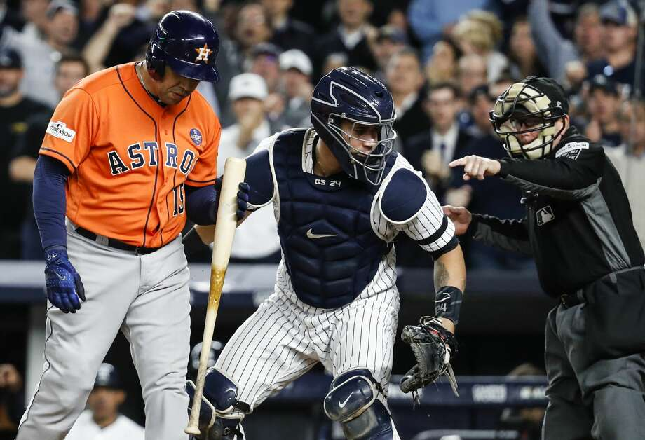 Houston Astros designated hitter Carlos Beltran (15) walks away from the plate after he was struck out by New York Yankees starting pitcher Masahiro Tanaka during the seventh inning of Game 5 of the ALCS at Yankee Stadium on Wednesday, Oct. 18, 2017, in New York. New York Yankees catcher Gary Sanchez (24) and umpire Jerry Meals are shown in the photo. ( Karen Warren  / Houston Chronicle ) Photo: Karen Warren/Houston Chronicle