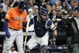 Houston Astros designated hitter Carlos Beltran (15) walks away from the plate after he was struck out by New York Yankees starting pitcher Masahiro Tanaka during the seventh inning of Game 5 of the ALCS at Yankee Stadium on Wednesday, Oct. 18, 2017, in New York. New York Yankees catcher Gary Sanchez (24) and umpire Jerry Meals are shown in the photo. ( Karen Warren  / Houston Chronicle )