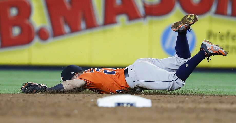 Houston Astros second baseman Jose Altuve dives and misses a grounder by New York Yankees shortstop Didi Gregorius, that went for a single, during the fifth inning of Game 5 of the ALCS at Yankee Stadium on Wednesday, Oct. 18, 2017, in New York. ( Karen Warren  / Houston Chronicle ) Photo: Karen Warren/Houston Chronicle
