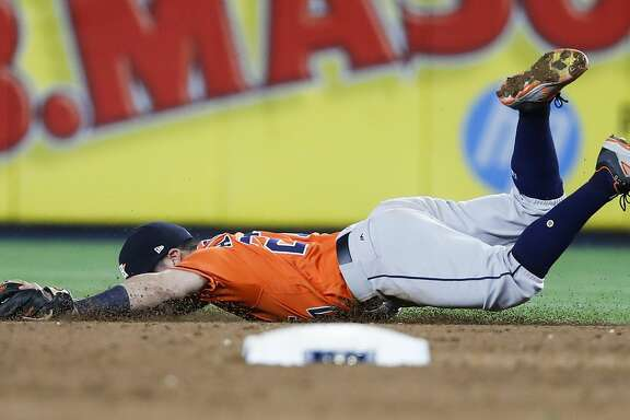 Houston Astros second baseman Jose Altuve dives and misses a grounder by New York Yankees shortstop Didi Gregorius, that went for a single, during the fifth inning of Game 5 of the ALCS at Yankee Stadium on Wednesday, Oct. 18, 2017, in New York. ( Karen Warren  / Houston Chronicle )
