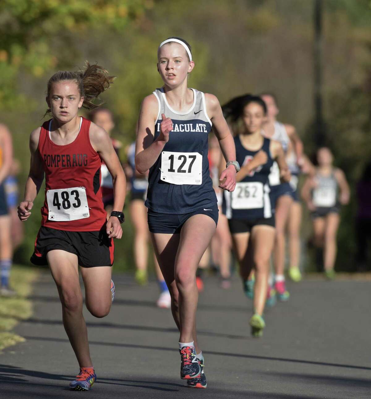 Pomperaug's Katherine Wiser (483) and Immaculate's Angela Saidman lead the pack in the SWC girls cross country championships Wednesday at Bethel High School. Wiser finished first and Saidman finished second in the championship race.