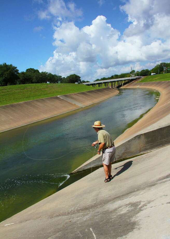 Flyfisher Mark Marmon targets grass carp on Brays Bayou, focus of the Invasive Fish Round-Up and Carp-A-Thon fishing tournament and fishing fair Oct. 28. Photo: Shannon Tompkins
