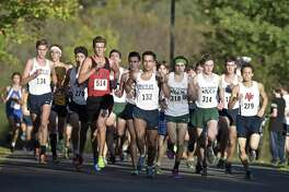 The lead pack makes its way around the course in the boys Cross Country SWC championships, Wednesday afternoon, October 18, 2017, at Bethel High School, Bethel, Conn.