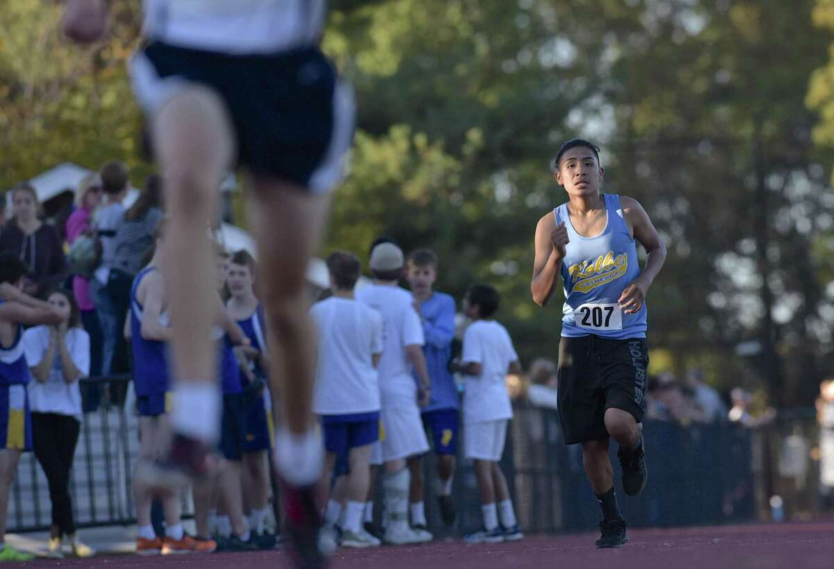 Kolbe Cathedral's Mario Mani (207) heads to the finish line in the boys Cross Country SWC championships, Wednesday afternoon, October 18, 2017, at Bethel High School, Bethel, Conn.