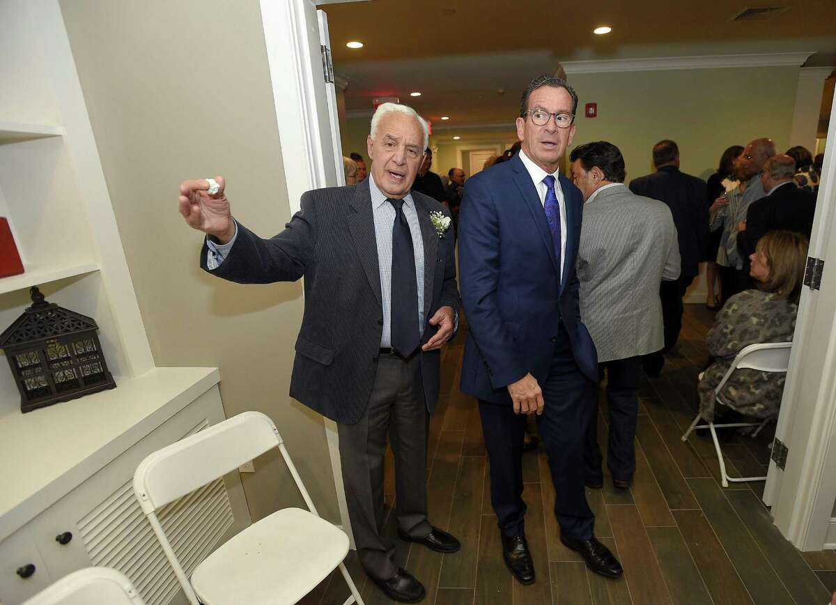 Larry Weisman, a member of the board of directors, guides Gov. Dannel P. Dannel Malloy on a tour during the opening reception for the Fairfield County Hospice House in Stamford on Wednesday.