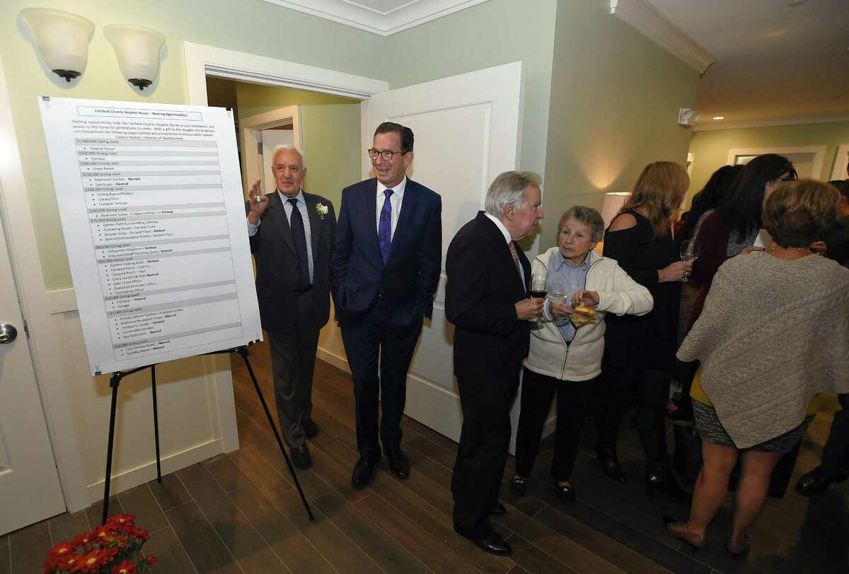 Larry Weisman, a member of the Board of Directors guides Dannel Malloy, Governor of Connecticut, on a tour during an opening reception for the Fairfield County Hospice House in Stamford, Connecticut on Wednesday, Oct.18, 2017. The house is the first residential house for hospice patients in Connecticut that provides end of life care, ensuring comfort, dinity, privacy, emotional and spiritual support, encouraging involvement of loved ones.