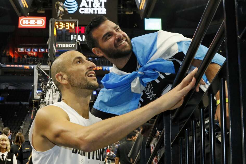 SAN ANTONIO,TX - OCTOBER 18: Manu Ginobili #20 of the San Antonio Spurs takes time to have his photo take with fellow countryman Damian Barrera at AT&T Center on October 18, 2017 in San Antonio, Texas.  NOTE TO USER: User expressly acknowledges and agrees that , by downloading and or using this photograph, User is consenting to the terms and conditions of the Getty Images License Agreement. (Photo by Ronald Cortes/Getty Images)