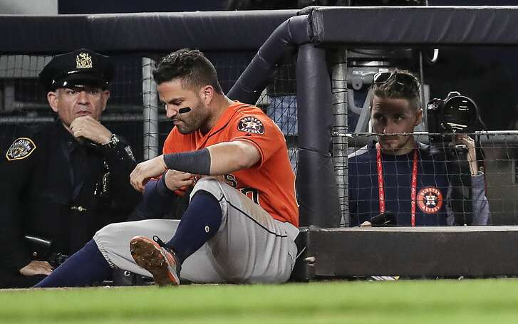 Houston Astros second baseman Jose Altuve sits at the end of the dugout after flying out during the top half of the ninth inning of Game 5 of the ALCS against the New York Yankees at Yankee Stadium on Wednesday, Oct. 18, 2017, in New York. The Yankees beat the Astros 5-0 to take a 3-2 lead in the best-of-seven series. ( Michael Ciaglo / Houston Chronicle )